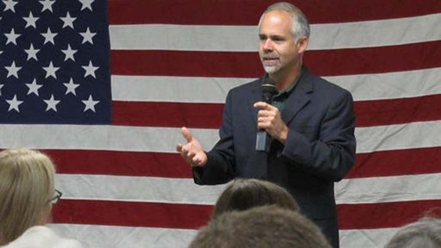In this July 25, 2016 photo, U.S. Rep. Tim Huelskamp, R-Kan., speaks during a campaign town hall meeting at the headquarters of Patriot Outfitters, which sells firearms, accessories and hunting and military gear in St. Marys, Kan. Huelskamp is locked in a tough GOP primary race against Roger Marshall, a Great Bend obstetrician. (AP Photo/John Hanna)