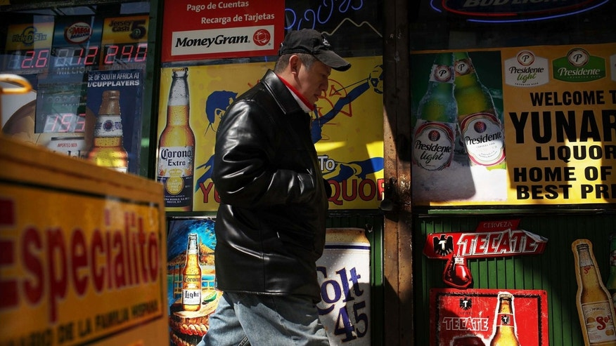 UNION CITY, NJ - MARCH 28: A man walks by adds in Spanish outside of a bodega on March 28, 2011 in Union City, New Jersey. Union City New Jersey, one of the stateÂs largest cities, has a population of Hispanic or Latino origin of over 80%. According to the new 2010 Census Bureau statistics reported last Thursday, the Hispanic population in the United States has grown by 43% in the last decade, surpassing 50 million and accounting for about 1 out of 6 Americans.  (Photo by Spencer Platt/Getty Images)
