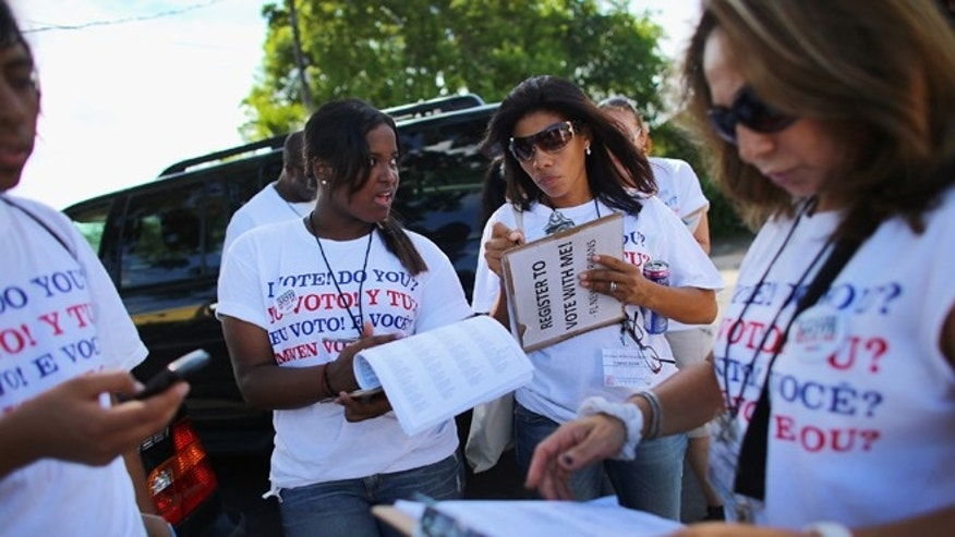 POMPANO BEACH, FL - OCTOBER 04:  Mary Collante (L) and Zunilda Boone along with other members of the Florida Immigrant Coalition prepare to go door to door looking to sign up voters during a voter registration drive by on October 4, 2012 in Pompano Beach, Florida. Efforts to get people to register to vote for the upcoming presidential election ends on Tuesday the 9th when the voting rolls close in Florida.  (Photo by Joe Raedle/Getty Images)