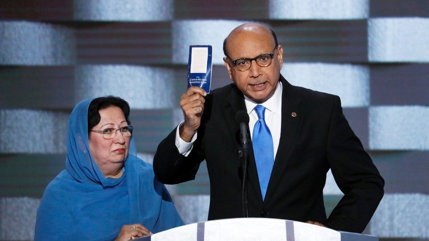 July 28, 2016: Khizr Khan, father of fallen US Army Capt. Humayun S. M. Khan holds up a copy of the Constitution of the United States as his wife listens during the final day of the Democratic National Convention in Philadelphia.