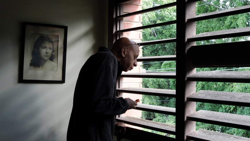 Cuba's dissident Guillermo Farinas looks out a window before a press conference in Havana, Cuba, Tuesday, Dec. 7, 2010. Farinas spent three weeks in the hospital early this year after a 134-day hunger strike to force the government to release opposition leaders jailed since 2003. (AP Photo/Franklin Reyes)