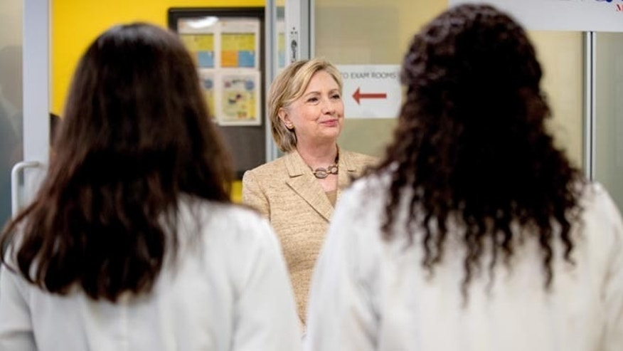 Democratic presidential candidate Hillary Clinton meets with doctors as she takes a tour of Borinquen Health Care Center, in Miami, Tuesday, Aug. 9, 2016, to see how they are combatting Zika. The center is within and serves the current area identified by the CDC where the Zika virus is being spread by mosquitos. (AP Photo/Andrew Harnik)