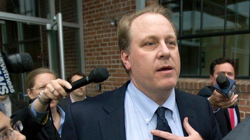In this Wednesday, May 16, 2012, file photo, former Boston Red Sox pitcher Curt Schilling, center, is followed by members of the media as he departs the Rhode Island Economic Development Corporation headquarters, in Providence, R.I.