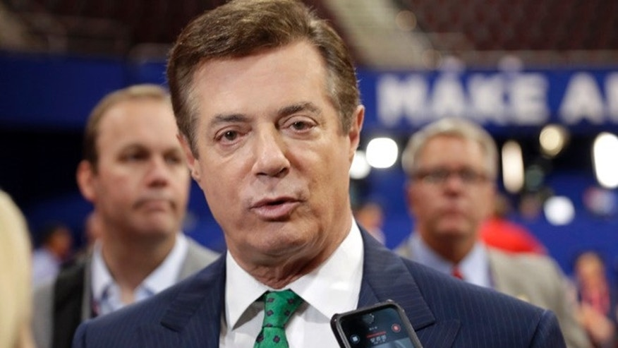 FILE - In this July 17, 2016 file photo, Trump Campaign Chairman Paul Manafort talks to reporters on the floor of the Republican National Convention at Quicken Loans Arena, Sunday, in Cleveland. (AP Photo/Matt Rourke, File)