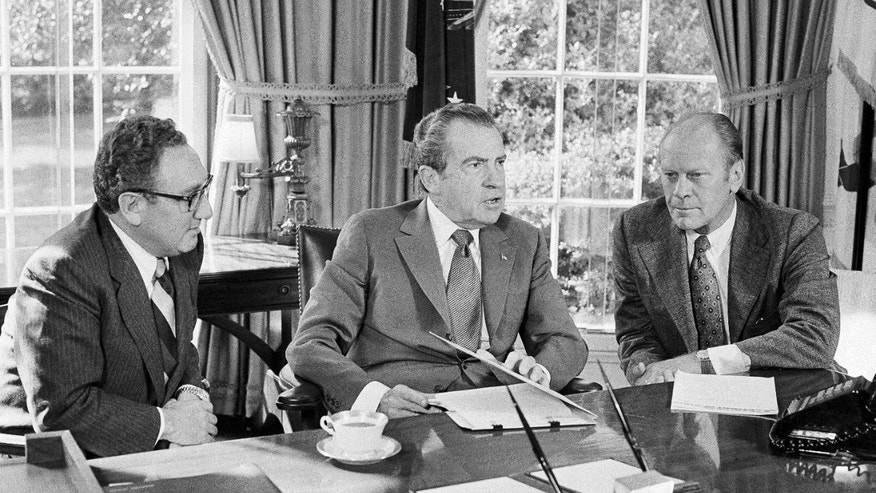 Oct. 13, 1973: Vice presidential nominee Gerald R. Ford, right, listens as President Richard Nixon speaks in the Oval Office of the White House in Washington.