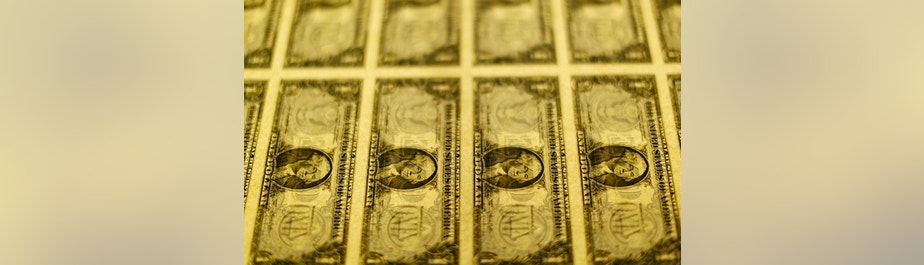 United States one dollar bills are seen on a light table at the Bureau of Engraving and Printing in Washington November 14, 2014.   REUTERS/Gary Cameron    (UNITED STATES - Tags: BUSINESS POLITICS) - RTR4E70P