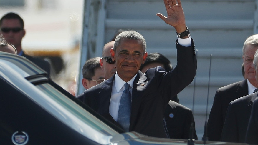 U.S. President Barack Obama waves has he arrives at the Hangzhou Xiaoshan International Airport, Saturday, Sept. 3, 2016, in Hangzhou, China, to attend the G-20 summit.