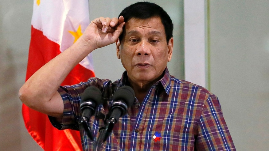 Aug. 31, 2016: Philippine President Rodrigo Duterte gestures as he addresses Overseas Filipino Workers who were repatriated back to the country.