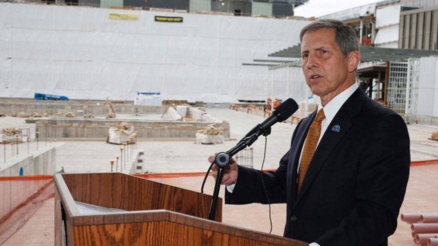 In this July 1, 2015 file photo, Veterans Affairs Deputy Secretary Sloan Gibson speaks near construction for the VA hospital during a news conference, in Aurora, Colo.