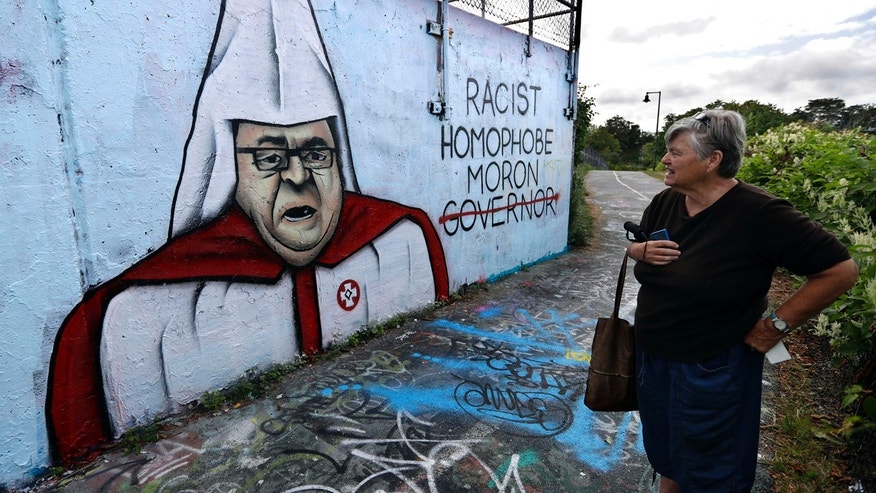 Sept. 6, 2016: Graffiti painted on a public art space depicts Gov. Paul LePage in a white hood and robe with a red Ku Klux Klan insignia.