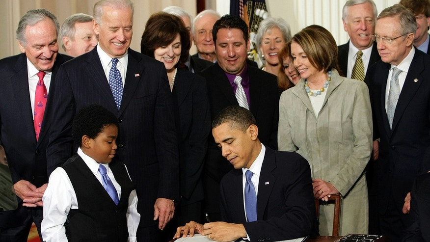 In this March 23, 2010, file photo, President Barack Obama signs the health care bill in the East Room of the White House in Washington.