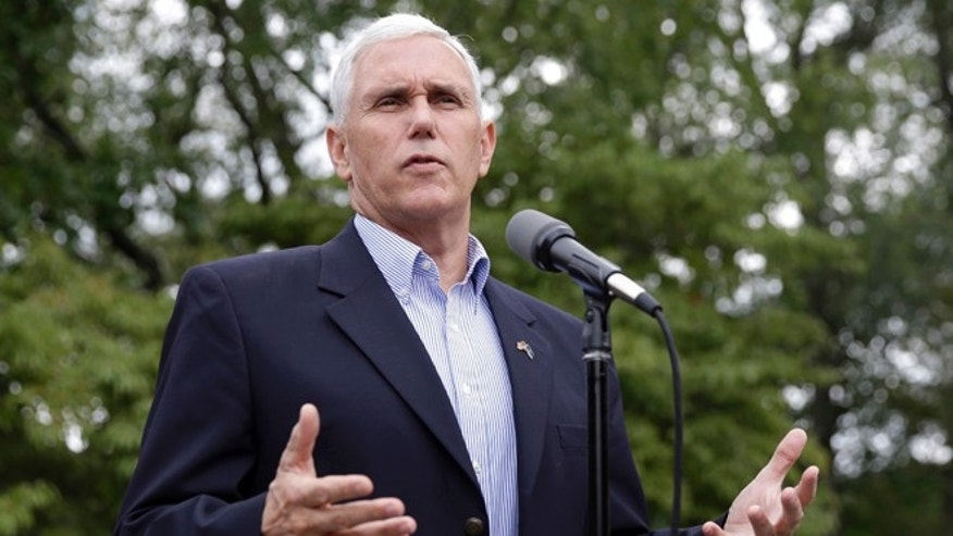 Republican vice presidential candidate, Indiana Gov. Mike Pence comments after receiving a national security briefing in Indianapolis, Friday, Sept. 9, 2016. (AP Photo/Michael Conroy)