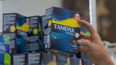 FILE - In this June 22, 2016 file photo, Tammy Compton restocks tampons at Compton's Market, in Sacramento, Calif. Gov. Jerry Brown on Tuesday, Sept. 13, 2016 rejected an attempt to waive taxes on tampons and other feminine hygiene products along with other proposed tax breaks, saying lawmakers should propose such ideas as part of the annual state budget process rather than as one-off exceptions. (AP Photo/Rich Pedroncelli,File)