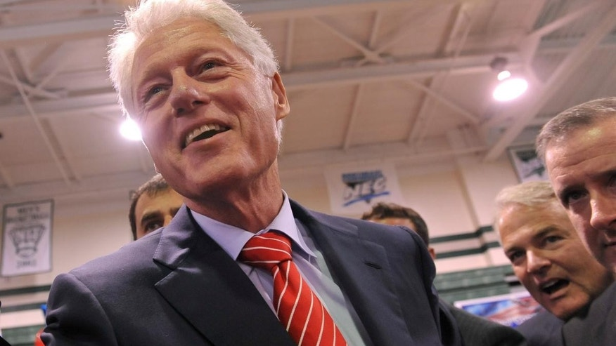 President Bill Clinton making a campaign stop (AP File Photo)
