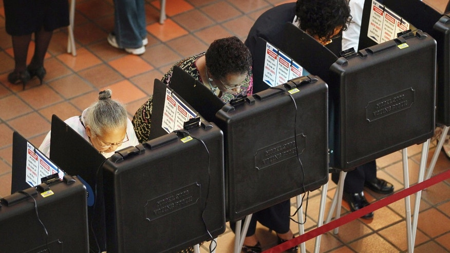 MIAMI - OCTOBER 18:  People cast their votes at a polling station set up at the Miami-Dade Government Center on October 18, 2010 in Miami, Florida. Florida residents headed to the polls to cast votes on the first day of early voting in teh midterm elections.  (Photo by Joe Raedle/Getty Images)