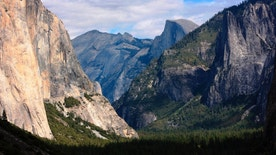 """FILE - This Oct. 2, 2013, file photo, shows a view seen on the way to Glacier Point trail in the Yosemite National Park, Calif. Sexual harassment, bullying and other misconduct is rampant among employees at national parks across the country, including at iconic sites such as Yosemite, Yellowstone and the Grand Canyon, a congressional committee was told Sept. 22, 2016. At Yosemite, at least 18 employees have come forward with allegations of harassment or other misconduct so severe that a recent report labeled working conditions at the park """"toxic."""" (AP Photo/Tammy Webber, File)"""