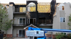 In this Sept. 14, 2016, photo, restoration work is performed at a Bellevue, Neb., apartment complex which was hit twice by fire. The second fire on July 26 destroyed the building, displacing dozens of people, and injured four, including a firefighter. The fires prompted City Councilman Don Preister to introduce a measure to ban smoking in city apartment complexes. (AP Photo/Nati Harnik)