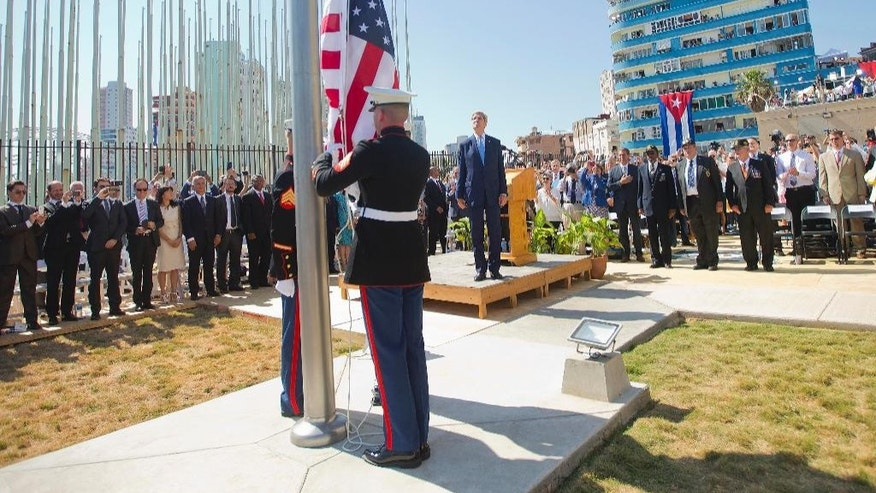 Aug. 14, 2015: Secretary of State John Kerry and other dignitaries watch as U.S. Marines raise the American Flag over the newly reopened embassy in Havana, Cuba