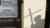 In this Jan. 22, 2009, file photo, the shadow of an anti-abortion activist holding a cross can be seen near a Planned Parenthood in Dubuque, Iowa.