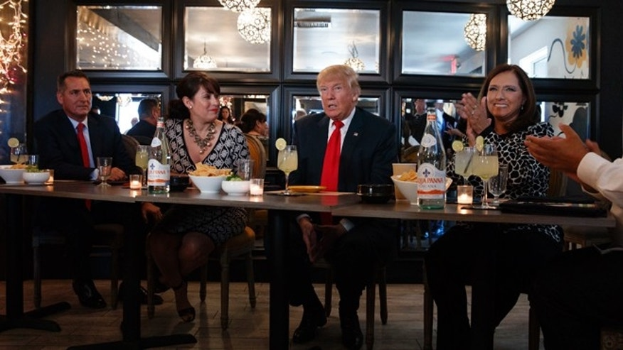 Republican presidential candidate Donald Trump meets with hispanic business leaders at El Sombrero Mexican Cafe, Wednesday, Oct. 5, 2016, in Las Vegas. (AP Photo/ Evan Vucci)