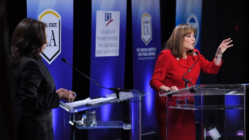 California U.S. Senate Democratic candidate Congresswoman Loretta Sanchez, right, speaks as fellow candidate California Attorney General Kamala Harris listens during a debate, Wednesday, Oct. 5, 2016, in Los Angeles.