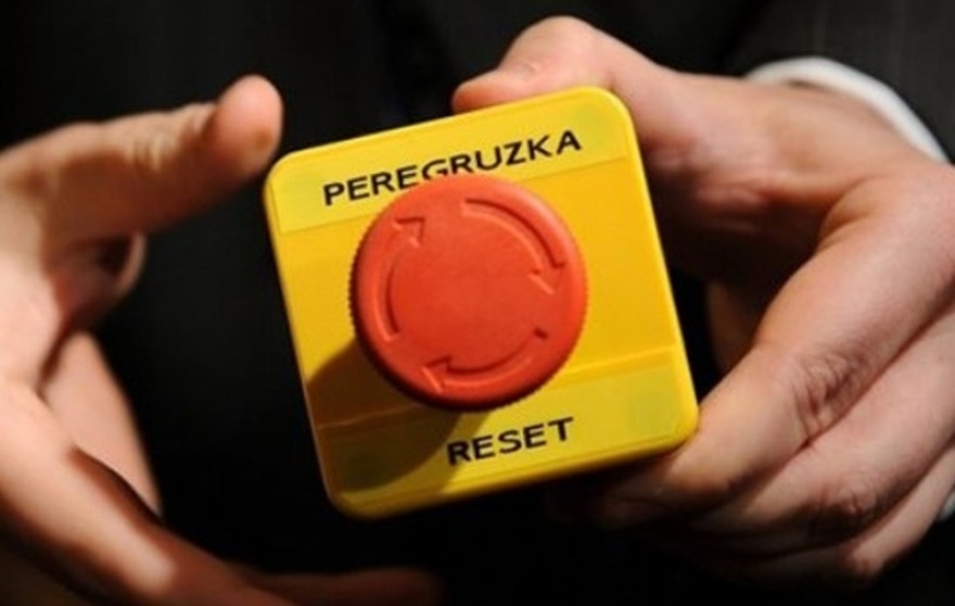 "An assistant shows the mock 'reset' button that US Secretary of State Hillary Clinton handed over to Russian Foreign Minister Sergei Lavrov during a meeting in Geneva, Switzerland, Friday, March 6, 2009. Clinton handed Lavrov the block with a red button marked ""reset"" in English and ""overload"" in Russian, a reference to a speech by new US Vice-President Joe Biden in January signalling that the Obama administration wanted vastly improved ties with Russia. (AP Photo/Fabrice Coffrini, Pool)"