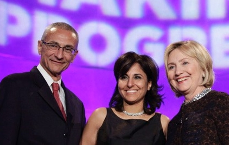 Former Secretary of State Hillary Clinton (R) poses with President of the Center for American Progress (CAP) Neera Tanden (C) and CAP founder and Chairman John Podesta at the 10th Anniversary policy forum in Washington, October 24, 2013. REUTERS/Yuri Gripas (UNITED STATES - Tags: POLITICS BUSINESS) - RTX14N4Y
