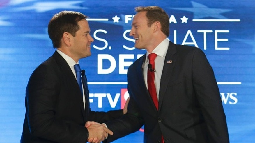 Sen. Marco Rubio and Rep. Patrick Murphy before their debate on Monday, Oct. 17, 2016, in Orlando, Fla.