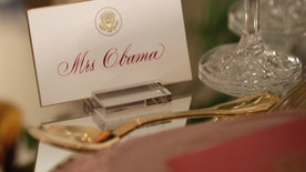 First lady Michelle Obama's place card is seen on a table during a preview in advance of the State Dinner in honor of the Official Visit of Italian Prime Minister Matteo Renzi and his wife Agnese Landini, Monday, Oct. 17, 2016, in the State Dining Room of the White House in Washington. (AP Photo/Carolyn Kaster)