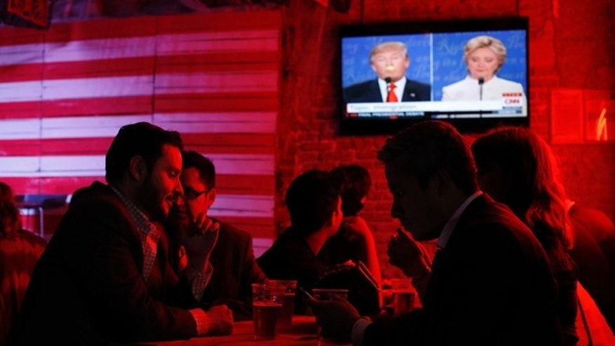 Customers watch the presidential debate at the Pinche Gringo BBQ restaurant in Mexico City, on Oct. 19, 2016.