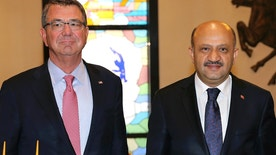 U.S Secretary of Defense Ash Carter, left, and his Turkish counterpart Fikri Isik pose for a photo before a meeting at Defense Ministry in Ankara, Turkey, Friday, Oct. 21, 2016. Carter met with his Turkish counterpart Isik and other top leaders and defense officials in Ankara amid escalating tensions between Turkey and Iraq over Turkish military operations in northern Iraq as allied forces move to retake Mosul from Islamic State militants.(Ozgur Yurdakadim/Turkish Defense Ministry, Pool photo via AP)