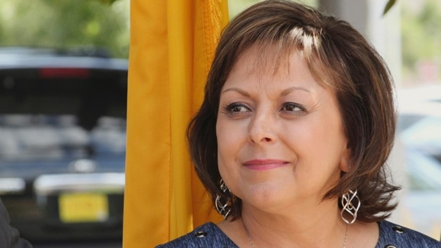 FILE - In this Sept. 15, 2016, file photo, New Mexico Gov. Susana Martinez awaits her turn to speak about Facebook's planned data center during a news conference in Los Lunas, N.M. Martinez on Tuesday, Sept. 20, 2016, stepped up pressure on lawmakers to consider reinstating the death penalty by promising to add the issue to a legislative agenda for a pending special session. (AP Photo/Susan Montoya Bryan, File)