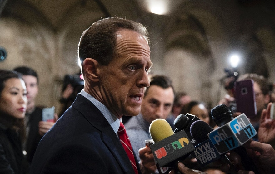 Republican Sen. Pat Toomey speaks with members of the media after a Pennsylvania U.S. Senate candidate debate with Democrat Katie McGinty at Temple University in Philadelphia, Monday, Oct. 24, 2016. (AP Photo/Matt Rourke)