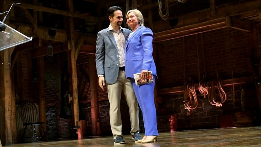 "NEW YORK - JULY 12: U.S. Democratic presidential candidate Hillary Clinton and Lin-Manuel Miranda, creator of the Broadway musical ""Hamilton"" stand onstage after a special performance of the Tony-winning musical  at the Richard Rodgers Theatre on July 12, 2016 in New York City. Clinton hosted a fundraiser at the special performance, with supporters paying from $2,700 to up to $100,000 for the chance to attend.  (Photo by Yana Paskova/Getty Images)"