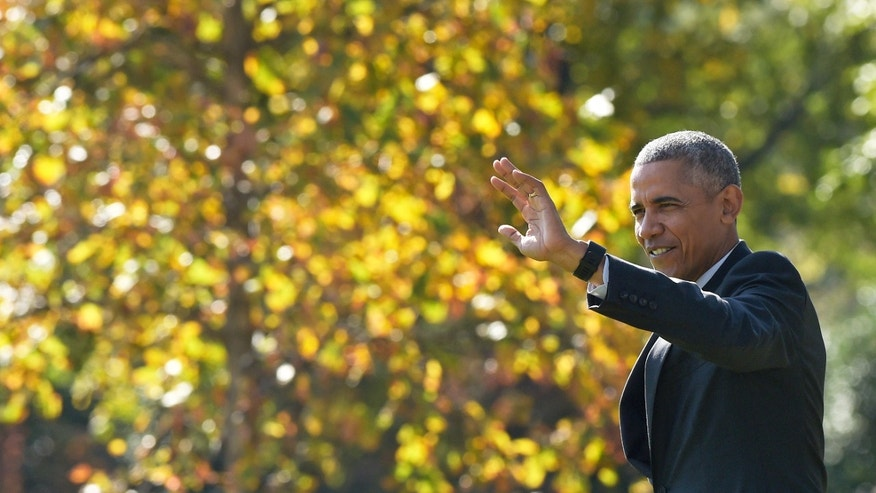 Nov. 4, 2016: President Barack Obama waves as he walks from the Oval Office to Marine One on the South Lawn of the White House in Washington.