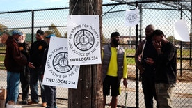 Signs hang on a telephone pole as workers picket across from the Callowhill SEPTA Depot Tuesday, Nov. 1, 2016, in Philadelphia. Commuters scrambled Tuesday to find alternate ways to travel as transit workers in Philadelphia hit the picket lines after the city's main transit agency and a union representing about 4,700 workers failed to reach a contract agreement. The union went on strike at 12:01 a.m. Tuesday, shutting down Southeastern Pennsylvania Transportation Authority buses, trolleys and subways that provide about 900,000 rides a day. (AP Photo/Jacqueline Larma)