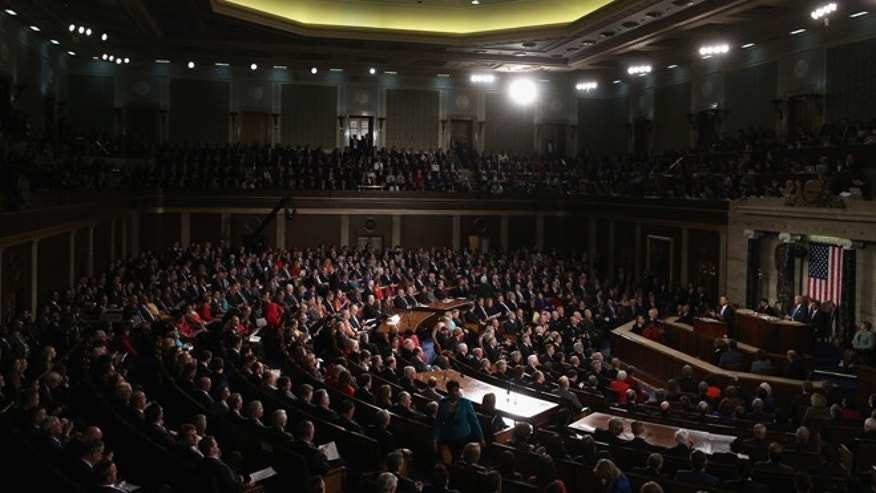 WASHINGTON, DC - JANUARY 28:  U.S. President Barack Obama delivers the State of the Union address to a joint session of Congress in the House Chamber at the U.S. Capitol on January 28, 2014 in Washington, DC. In his fifth State of the Union address, Obama is expected to emphasize on healthcare, economic fairness and new initiatives designed to stimulate the U.S. economy with bipartisan cooperation.  (Photo by Mark Wilson/Getty Images)