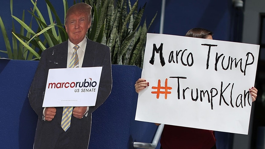MIAMI, FL - SEPTEMBER 08:  Daniela Martins stands next to a cardboard cutout of Republican presidential candidate Donald Trump as she joins a protest outside the Miami office of Sen. Marco Rubio (R-FL) on September 8, 2016 in Miami, Florida.  The protesters from the Florida immigrant community held the rally to denounce what they say is Mr. Rubio's support of Donald Trump and to kick off efforts to hold elected officials accountable for their anti-immigration policy positions.  (Photo by Joe Raedle/Getty Images)