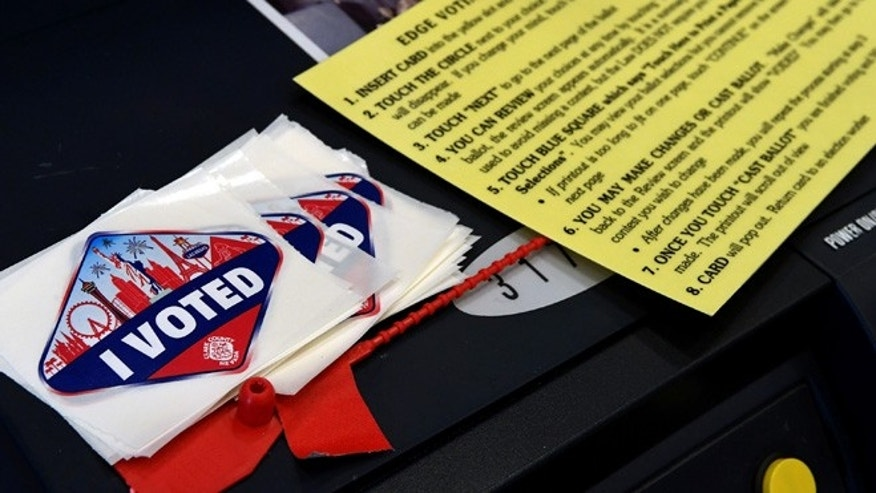 "LAS VEGAS, NV - NOVEMBER 08:  Las Vegas Strip-themed ""I Voted"" stickers are stacked next to a voting instruction card on the back of a voting machine at a polling station at John W. Bonner Elementary School on Election Day on November 8, 2016 in Las Vegas, Nevada. Americans across the nation are picking their choice for the next president of the United States.  (Photo by Ethan Miller/Getty Images)"
