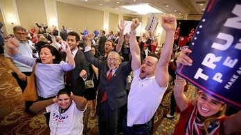 Trump supporters react as Fox News predict Republican presidential candidate Donald Trump will carry North Carolina, at  the Republican Party of Seminole County, Fla. election watch event in Altamonte Springs, near Orlando, Fla., Tuesday, Nov. 8, 2016.  (Joe Burbank/Orlando Sentinel via AP)