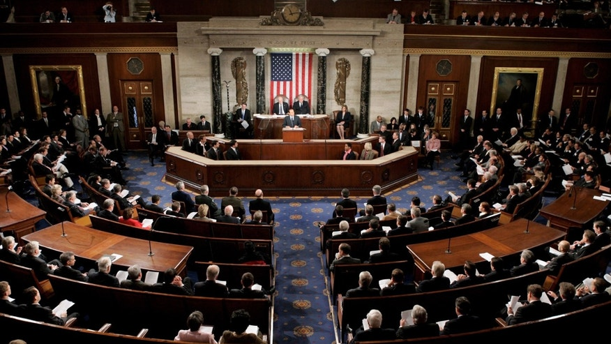 WASHINGTON - MARCH 1:  Italian Prime Minister Silvio Berlusconi addresses U.S. legislators in the chamber of the U.S. House of Representatives at the U.S. Capitol during a joint meeting of Congress March 1, 2006 in Washington, DC. Berlusconi faces a challenging election in April and was praised by U.S. President George W. Bush yesterday for bringing ?stability to the Italian government.?  (Photo by Mark Wilson/Getty Images)