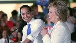 "SAN ANTONIO, TX - OCTOBER 15:  Secretary of Housing and Urban Development Secretary Julian Castro introduces Democratic presidential candidate Hillary Clinton at a ""Latinos for Hillary"" grassroots event October 15, 2015 in San Antonio, Texas. The event was part of the campaign's ongoing effort to build an organization outside of the four early states and work hard for every vote.  (Photo by Erich Schlegel/Getty Images)"