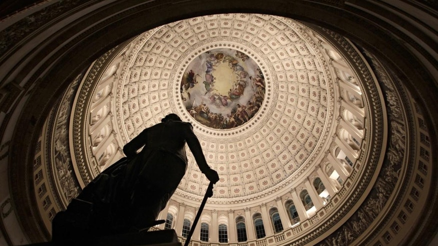 The rotunda of the U.S. Capitol is seen, Friday evening, Feb. 18, 2011, as Republicans and Democrats square off over a spending bill in the House of Representatives with votes and activity scheduled throughout the night on Capitol Hill in Washington. (AP Photo/J. Scott Applewhite)
