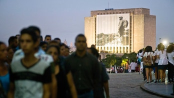 A photograph of the late Fidel Castro hangs on a building in Revolution Plaza where people wait in line to pay their last respects in Havana, Cuba, Monday, Nov. 28, 2016. Cuba's government declared nine days of national mourning following Castro's death on Nov. 25. (AP Photo/Ramon Espinosa)