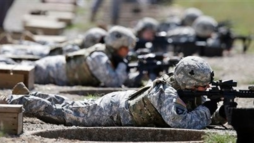 Sept. 18, 2012: Female soldiers train on a firing range while wearing new body armor in Fort Campbell, Ky