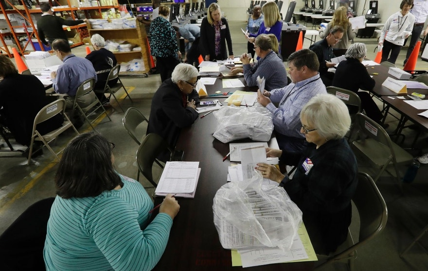 Workers begin a statewide presidential election recount Thursday, Dec. 1, 2016, in Milwaukee. The first candidate-driven statewide recount of a presidential election in 16 years began Thursday in Wisconsin, a state that Donald Trump won by less than a percentage point over Hillary Clinton after polls long predicted a Clinton victory. (AP Photo/Morry Gash)