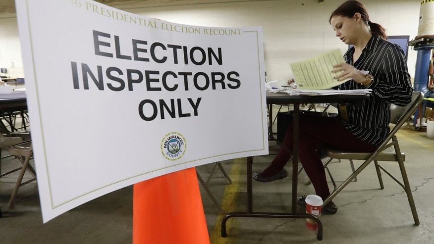 Nicole Kirby looks over results during a statewide presidential recount in Wisconsin