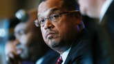 FILE - In a Dec. 2, 2016 file photo, U.S. Rep. Keith Ellison, D-Minn., listens with Jamie Harrison, back, chair of the South Carolina Democratic Party, as Ray Buckley, chair of the party in New Hampshire, speaks during a forum on the future of the Democratic Party, in Denver.  Ellison said Wednesday, Dec. 7, 2016,  that he'll resign his seat in Congress if he's picked as chairman by DNC members at the late February elections. (AP Photo/David Zalubowski, File)