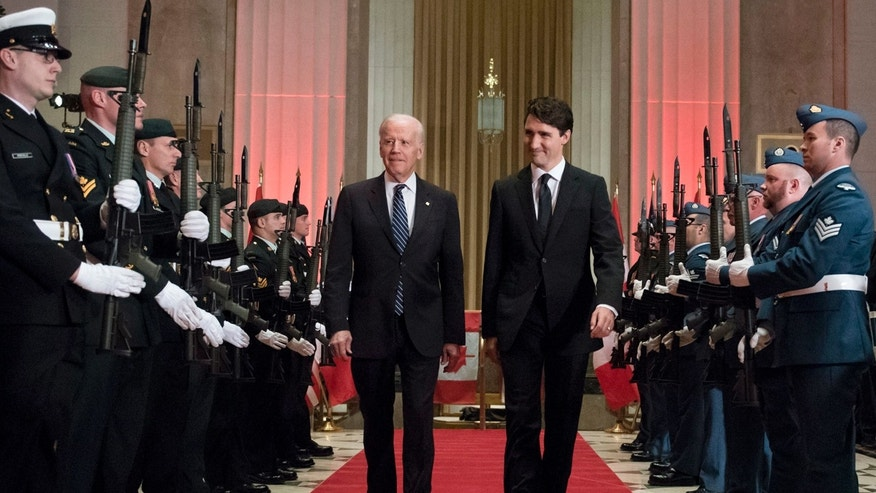 Prime Minister Justin Trudeau and U.S. Vice-President Joe Biden arrive at a state dinner on Thursday, Dec. 8, 2016 in Ottawa. (Justin Tang/The Canadian Press via AP)
