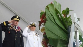 U.S. Army Major General Mark J. O'Neil (C), U.S. Navy Admiral Harry Harris (R) and United States Senator Mazie Hirono (L) and Hawaii Governor David Ige present the VP Wreath during ceremonies honoring Veterans Day at the National Memorial Cemetery of the Pacific at Punchbowl in Honolulu, Hawaii, November 11, 2016. REUTERS/Hugh Gentry  - RTX2TA9S